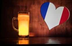 Soccer 2018. Single beer glass on table at dark toned foggy background. Support France with beer concept. royalty free stock images