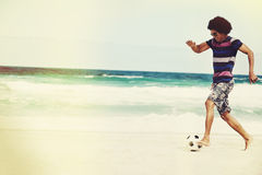 Soccer skill beach. Hispanic Brasil man playing soccer on beach with dribble skill and ball on vacation Royalty Free Stock Images