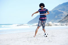 Soccer skill beach. Hispanic Brasil man playing soccer on beach with dribble skill and ball on vacation Stock Photography