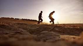 Soccer. sky two men play soccer sunlight football the beautiful silhouettes sport against sunset stock video
