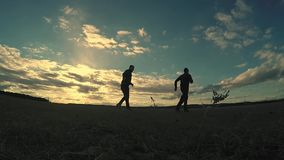 Soccer. sky two men play sport soccer the beautiful silhouettes football stock video footage