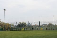 Soccer. Field with goal posts and light poles Royalty Free Stock Photo