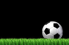 Soccer Sport Concept. Soccer or European football team sport concept with a leather ball sitting on grass ready for a kick on a black night sky as a sporting Stock Photo
