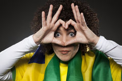 Soccer Sport Fan Supporter Brazil with heart. Young woman. A fan / supporter from brazil Stock Photos