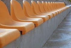 Soccer stadium. Chairs on football stadium Royalty Free Stock Photo