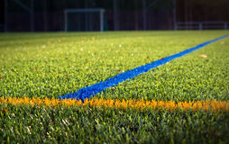 Soccer Stadium. Photograph of a lighted green soccer stadium grass field Stock Image
