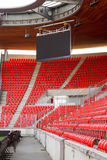Soccer stadium. View on corner of an empty football (soccer) stadium with red seats and projection screen stock photos