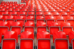 Soccer stadium. Detailed view on red seats on a football (soccer) stadium Stock Photography