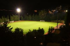 Soccer stadium. Spotlighted soccer stadium in the night Stock Photos