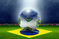 Soccer stadium, ball, globe, flag of Brazil Stock Images
