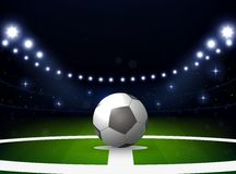 Soccer stadium with ball and spotlight at night Royalty Free Stock Photo