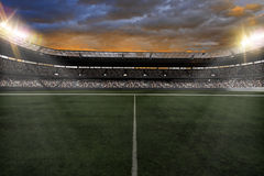 Soccer Stadium. With fans wearing white uniforms Royalty Free Stock Photography