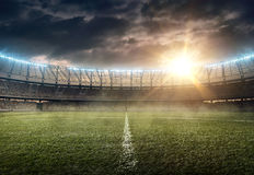 Soccer stadium 8. Soccer stadium with green grass and illumination Stock Images