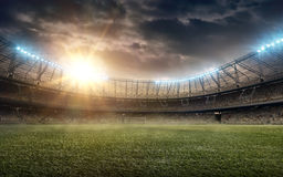 Soccer stadium 4. Soccer stadium with green grass and illumination Royalty Free Stock Photography