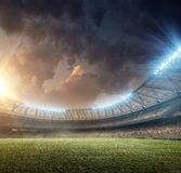 Soccer stadium 1. Soccer stadium with green grass and illumination Royalty Free Stock Image
