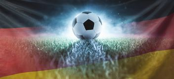 Soccer on stadium lawn with Germany flag stock photography