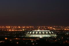 Soccer Stadium at night. Soccer world cup  stadium in South Africa, Port Elizabeth at night with city lights Royalty Free Stock Image