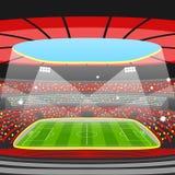 Soccer stadium during sports match. Football arena field Stock Photos