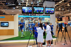 Soccer stand at exhibition. Two women preparing soccer stand at photographic and imaging trade fair Royalty Free Stock Photo