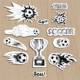 Soccer stickers on wood background Royalty Free Stock Photography