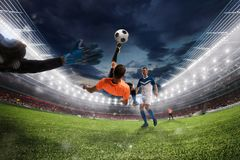 Soccer striker hits the ball with an acrobatic bicycle kick. 3D Rendering stock image