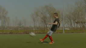 Soccer striker shooting on goal during training stock video footage