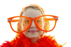 Soccer supporter with big orange glasses. Portrait of a soccer supporter with big orange glasses over white background Stock Photos