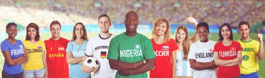 Soccer supporter from Nigeria with fans other countries at stadi. Soccer supporter from Nigeria with fans from Germany, Russia, Brazil and other countries at Stock Photo