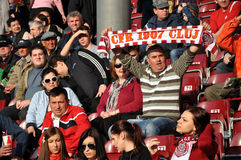 Soccer supporters during a game. CLUJ NAPOCA, ROMANIA - MARCH 17: FC CFR Cluj team supporters show his support during a game in League 1 against FC Pandurii Royalty Free Stock Photography