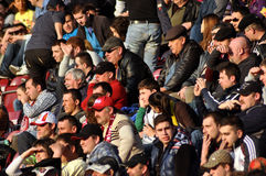 Soccer supporters during a game. CLUJ NAPOCA, ROMANIA - MARCH 17: FC CFR Cluj team supporters show his support during a game in League 1 against FC Pandurii Royalty Free Stock Image