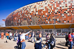 Soccer Supporters at Soccer City - FIFA WC. Soccer fans milling around outside the stadium before the start of the game Stock Images