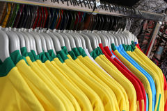 Soccer t-shirts for sale in the sports shop Stock Images