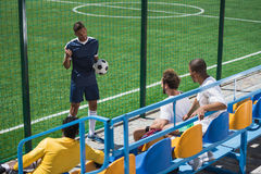 Soccer team discussing game strategy before match. Young soccer team discussing game strategy before match Royalty Free Stock Photo