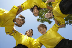 Soccer Team Forming Huddle Royalty Free Stock Images