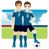 Soccer Team Friends. Two soccer team friends in uniform standing on field Royalty Free Stock Photography