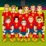 Soccer Team Portrait. Full soccer team posing on soccer field ready to play Stock Photo