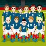 Soccer Team Posing. Full soccer team posing on soccer field ready to play Stock Photo