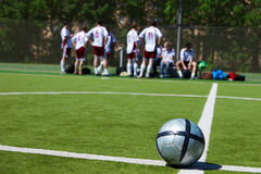 Soccer team resting on background royalty free stock photography