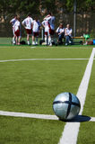 Soccer team resting on background Stock Photography