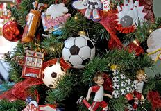 Soccer Themed Christmas Tree. This Christmas tree has a sports theme going, with soccer being the main point, with soccer ball lights Stock Images