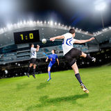 Soccer time. Soccer or football  player on the field Stock Images