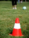 Soccer training. In a summer day,a cone in foreground Royalty Free Stock Image
