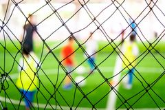 Soccer training blur on training ground with children. Soccer training net blur on training ground with children stock image