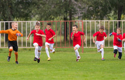 Soccer training for kids. In football field royalty free stock image