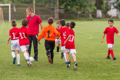 Soccer training for kids. In football field stock photo