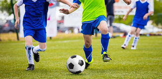 Soccer Training Match For Children Youth Teams. Young Boys Running on the Pitch Stock Photography