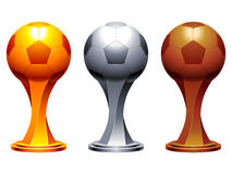 Soccer trophy cups. Golden, silver and bronze soccer balls as trophy cups Royalty Free Stock Image