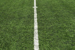 Soccer turf center line. Center line on green soccer turf or grass Stock Photo