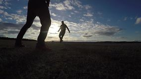 Soccer. Two men play soccer football sky sport the beautiful silhouettes against stock video