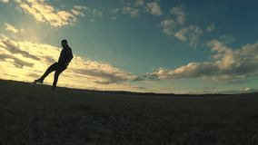 Soccer. Two men play soccer sport football silhouettes against the beautiful sky stock video